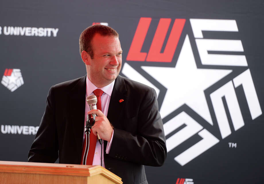 Jason Henderson, Lamar University athletic director, grins as he talks about the university's future softball field Friday afternoon. Lamar University broke ground on their new softball facility Friday afternoon. The new field will be located next to the soccer and baseball complexes. Photo taken Friday 10/17/14 Jake Daniels/@JakeD_in_SETX Photo: Jake Daniels / ©2014 The Beaumont Enterprise/Jake Daniels