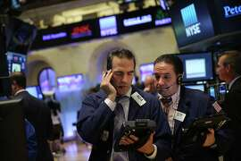Traders work on the floor of the New York Stock Exchange (NYSE) on August 25. U.S. stocks had an early rally Wednesday, with the Dow up more than 200 points just before 8 a.m.