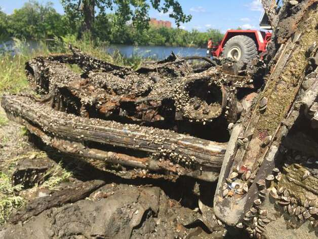 Cars pulled from the Hudson River in Troy on Wednesday were covered with mussels and mud from years of being submerged. (Lori Van Buren / Times Union)