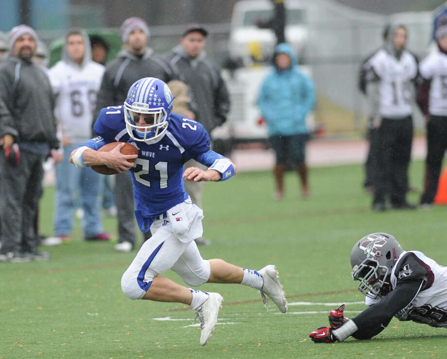 Darien running back Shelby Grant (#21)  on a run during the Class L high school football semi-final betweeen Darien High School and Naugatuck High School at Darien, Conn., Saturday, Dec. 6, 2014. Darien advanced to the final with a 42-12 victory over Naugatuck. Photo: Bob Luckey / Bob Luckey / Greenwich Time