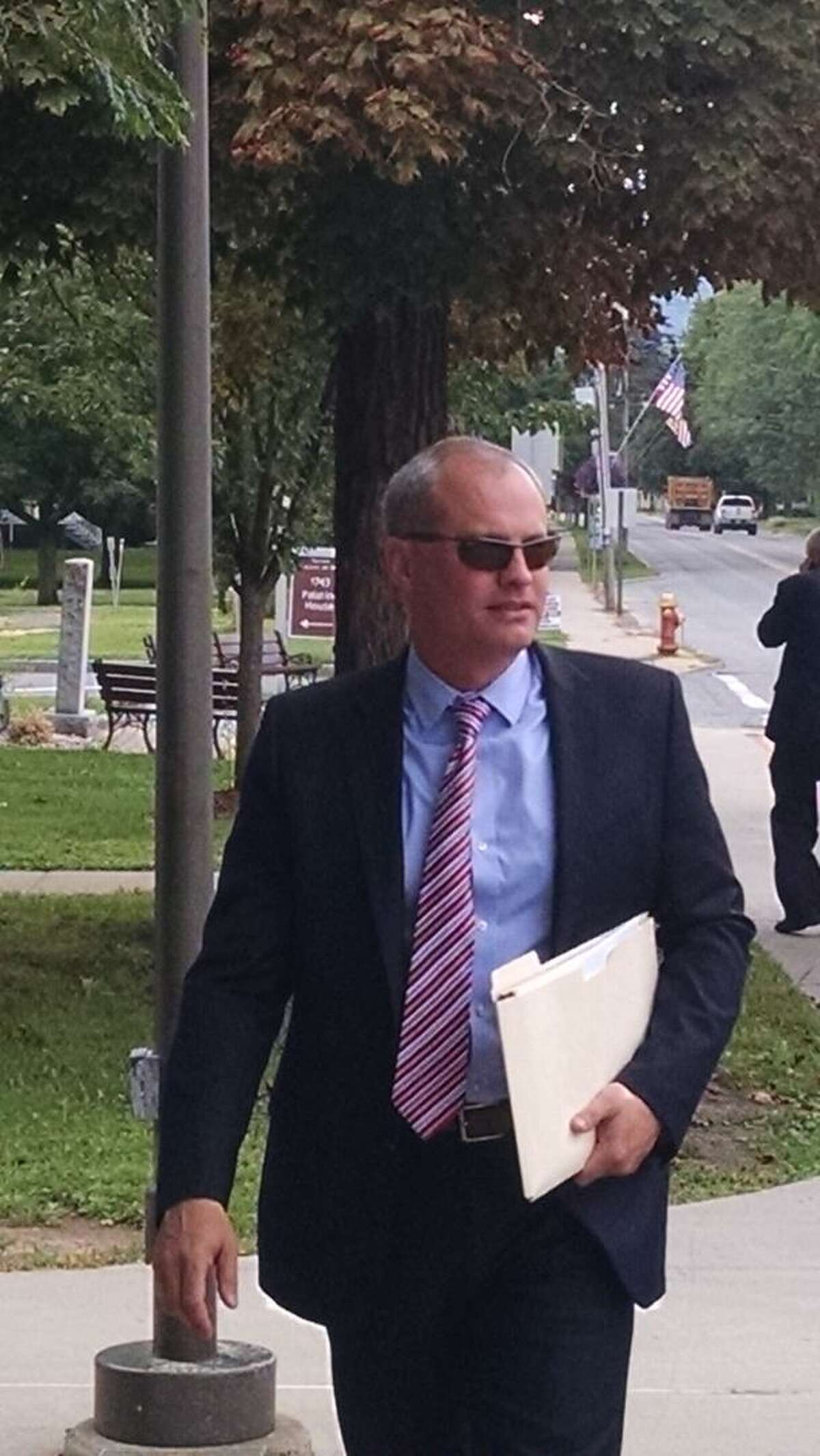 Tioga County District Attorney Kirk Martin walks into Schoharie County Court for conference on a potential fourth trial for Cal Harris, the Binghamton-area man accused of killing his wife on Sept. 11, 2001. (Robert Gavin / Times Union)