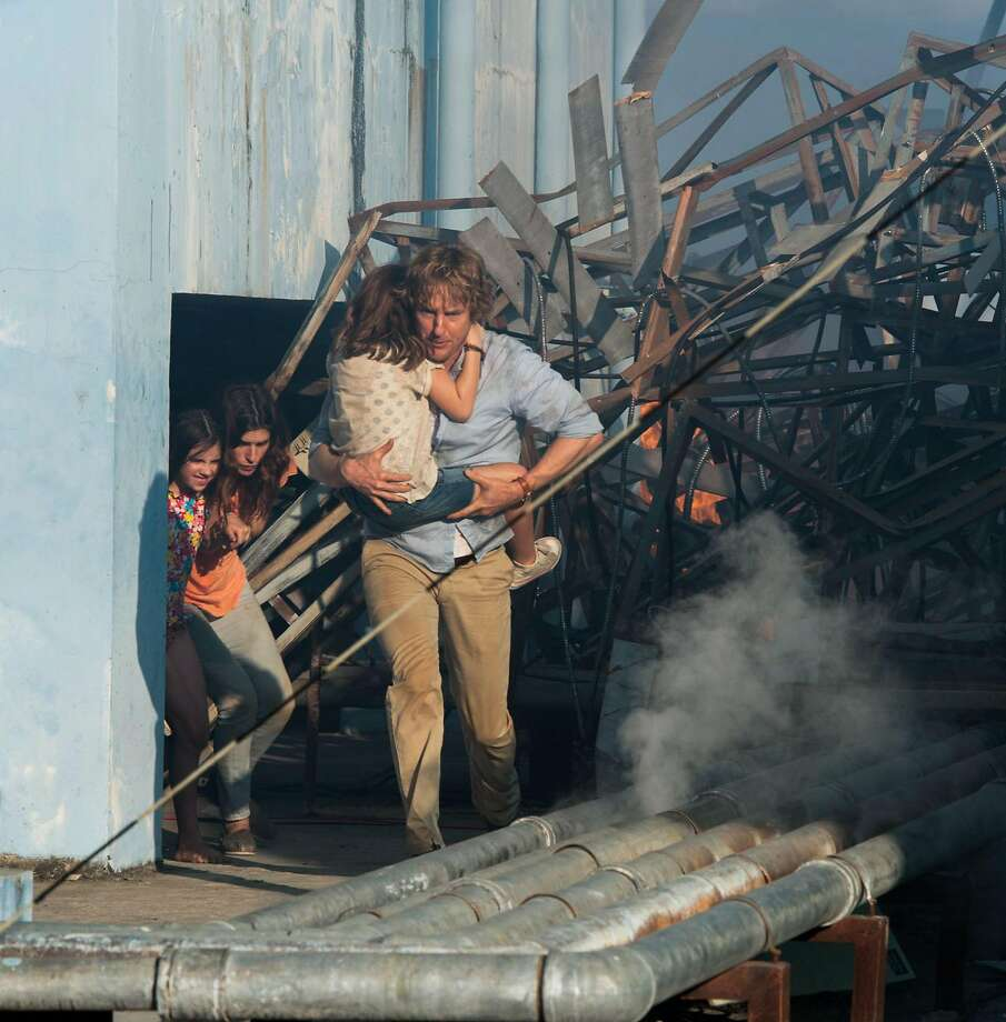 """Owen Wilson plays an American corporate worker abroad forced to turn action hero to protect his wife (Lake Bell, center) and children after a coup in """"No Escape."""" Photo: Roland Neveu/Weinstein Company, McClatchy-Tribune News Service"""