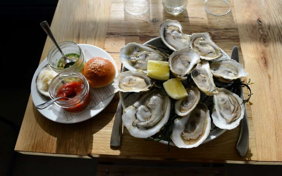 """The Whelk - Westport """"Established Chef Bill Taibe is at the helm of The  Whelk, a restaurant and seafood bar in Saugatuck, but Executive Chef  Anthony Kostelis creates the outstanding menu diners experience every  day. The menu includes a changing selection of wild and farmed oysters  served with a mignonette with a hint of jalapeno. Guests can also enjoy  oyster shooters and roasted oysters."""" Read more at CT Bites. Photo: Christian Abraham"""