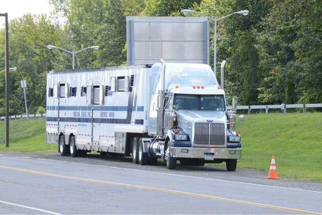 American Pharoah's trailer waits for the Triple Crown winner's arrival Wednesday at Albany International Airport. The thoroughbred is going to run in Saturday's Travers Stakes. (Will Waldron / Times Union)