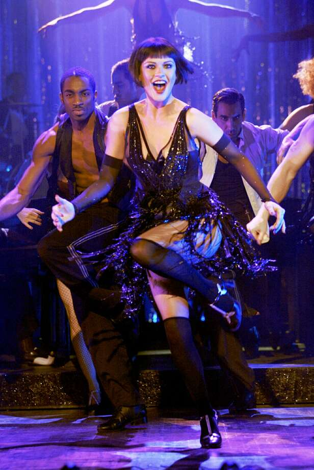 "CHICAGO  (2002, musical) - Actress Catherine Zeta-Jones is shown in a scene from the film ""Chicago"" in this undated  photo. ""Chicago"" received a leading eight Golden Globe nominations Thursday, Dec. 19, 2002 including best musical or comedy and best actress for stars Zeta-Jones and Renee Zellweger. (AP Photo/Miramax Films)  HOUCHRON CAPTION (12/27/2002):  RAZZLE DAZZLE - The movie musical makes a strong comeback with ""Chicago,"" which opens today with a stellar cast including Catherine Zeta-Jones.  INSIDE.   HOUCHRON CAPTION  (10/12/2003):  Catherine Zeta-Jones performs in a scene from Chicago, a film that was, title notwithstanding, made in Canada. Photo: DAVID JAMES, HO / MIRAMAX FILMS"