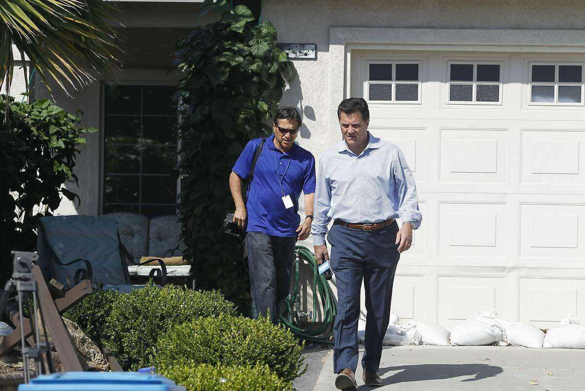 Television reporters walk away from the home of Vester Flanagan Sr. after no one answered the door in Vallejo, Calif. on Wednesday, Aug. 26, 2015. Flanagan's son Vester Lee Flanagan, who also goes by the name of Bryce Williams, is believed to have shot and killed two television journalists in Virginia while they were reporting live on the air earlier this morning and was later critically injured with a self-inflicted gunshot wound.