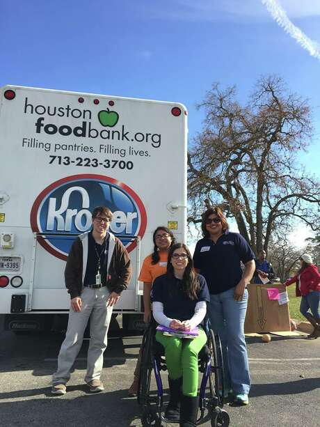 Spencer Brown, left, spent the past year working at the Houston Food Bank through the Americorps VISTA program.