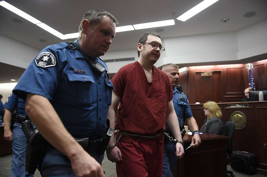James Holmes is led from the Centennial, Colo., courtroom where he was sentenced for a 2012 movie theater massacre. Photo: RJ Sangosti, Associated Press