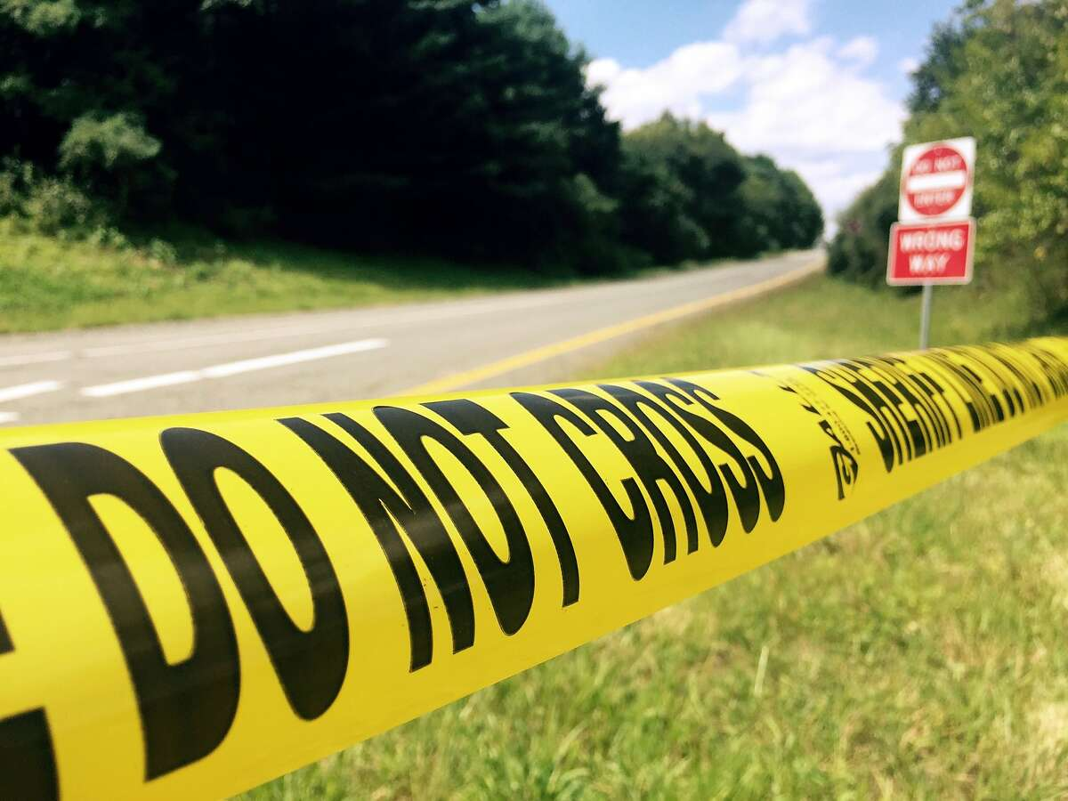 """Sheriff's department tape blocks an off ramp from Interstate 66 near Markham, Virginia on August 26, 2015 where police confronted suspected killer Vester Lee Flanagan also known as Bryce Williams. The US man suspected of killing two journalists during a live television interview on Wednesday was taken into police custody with """"life-threatening injuries"""" after apparently shooting himself, Virginia state police said. WDBJ reporter Alison Parker, 24, and cameraman Adam Ward, 27, were shot at close range while conducting an on-air interview. AFP PHOTO/ ROBERT MACPHERSONRobert MacPherson/AFP/Getty Images"""