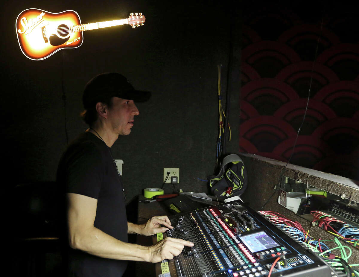 Michael Morales works the American Kings show Saturday July 25, 2015 at Fitzgerald's Bar & Music.