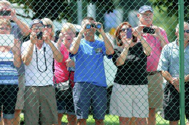 "Racing rans line the fence by the firehouse at Albany International Airport to try to get a glimpse of Triple Crown winner and Travers hopeful American Pharoah Wednesday, Aug. 26, 2015, in Colonie, N.Y. Pharoah flew out from California aboard a H. E. ""Tex"" Sutton Forwarding Company Boeing 727-200. (Will Waldron/Times Union) Photo: WW / 00033098A"