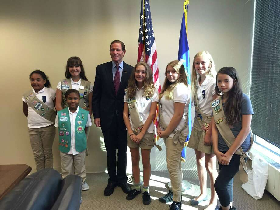 Girl scouts from Ridgefield and East Hartford met with Senator Richard Blumenthal to share their views on who should be the first woman on the $10 bill. From left to right with Blumenthal: Katie Lopez, Melanie Valdes, Gaita Cisse (in front of her), Angelica DeDominicis, Kayla Michaud, Cecilie Johnsrud, and Tristen Connelly. Photo: Girl Scouts Of Connecticut