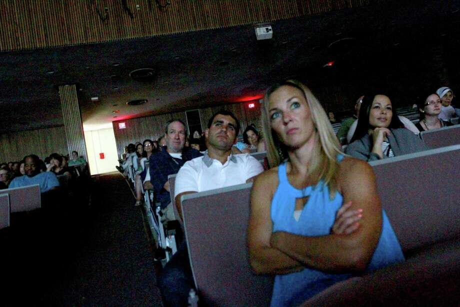 Jessica Petrizzo, foreground, a Spanish teacher at Westhill High School, watches a videotaped greeting by Stamford Superintendent of Schools Winifred Hamilton during the annual convocation at the high school in Stamford on Wednesday. Photo: Matthew Brown / For Hearst Connecticut Media / Connecticut Post Freelance