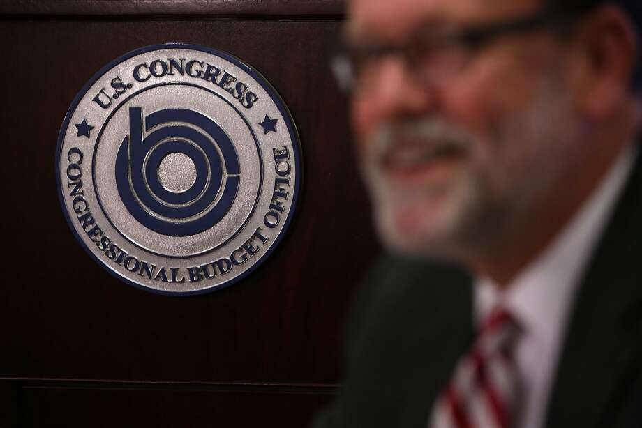 Congressional Budget Office Director Keith Hall briefs the media on this week's budget update. Photo: Alex Wong, Getty Images
