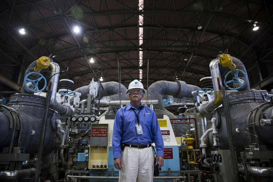 Monday August 24, 2015 Jearl Strickland director of Director Technical Services at Pacific Gas and Electric Company Diablo Power Plant stands in front of the electricity generating Turbine 2, located in the Diablo Canyon Power Plant in San Luis Obispo County, Calif. (Nancy Pastor/For the San Francisco Chronicle) Photo: Nancy Pastor, Nancy Pastor For The SF Chronicl