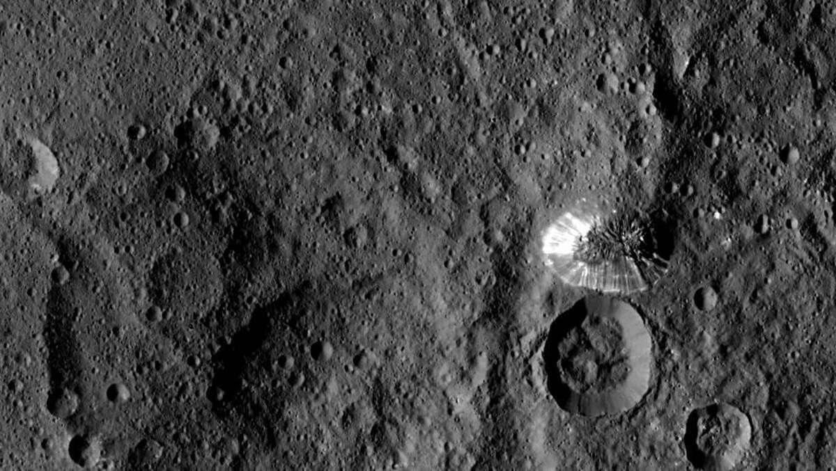 NASA's Dawn spacecraft spotted this tall, conical mountain on Ceres from a distance of 915 miles (1,470 kilometers). The mountain, located in the southern hemisphere, stands 4 miles (6 kilometers) high. Its perimeter is sharply defined, with almost no accumulated debris at the base of the brightly streaked slope.