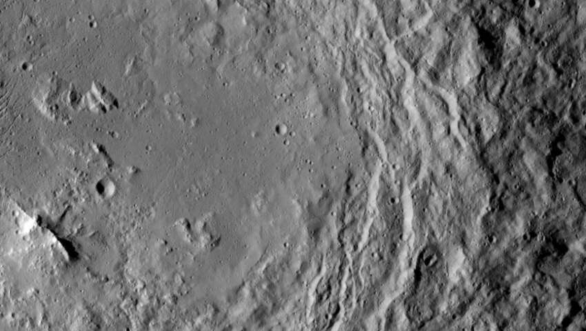 NASA's Dawn spacecraft took this image that shows a mountain ridge, near lower left, that lies in the center of Urvara crater on Ceres.