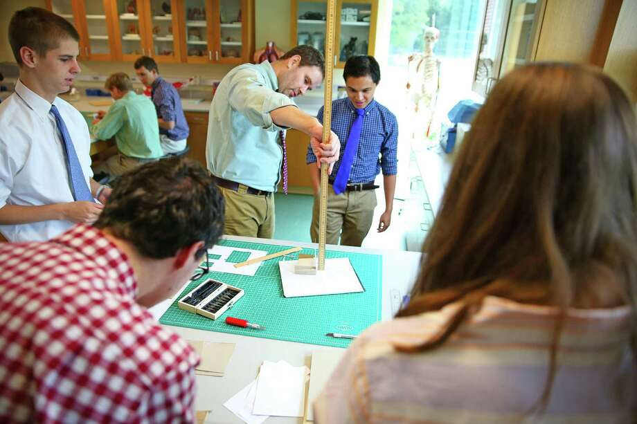 Design Lab Director Michael Mitchell works with students in St. Luke's School  new science wing in New Canaan, Conn. Photo: Desiree Smock / Contributed Photo / Connecticut Post Contributed