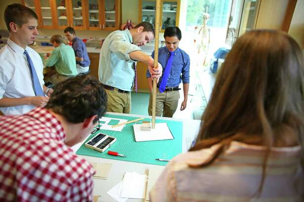 Design Lab Director Michael Mitchell works with students in St. Luke's School  new science wing in New Canaan, Conn.