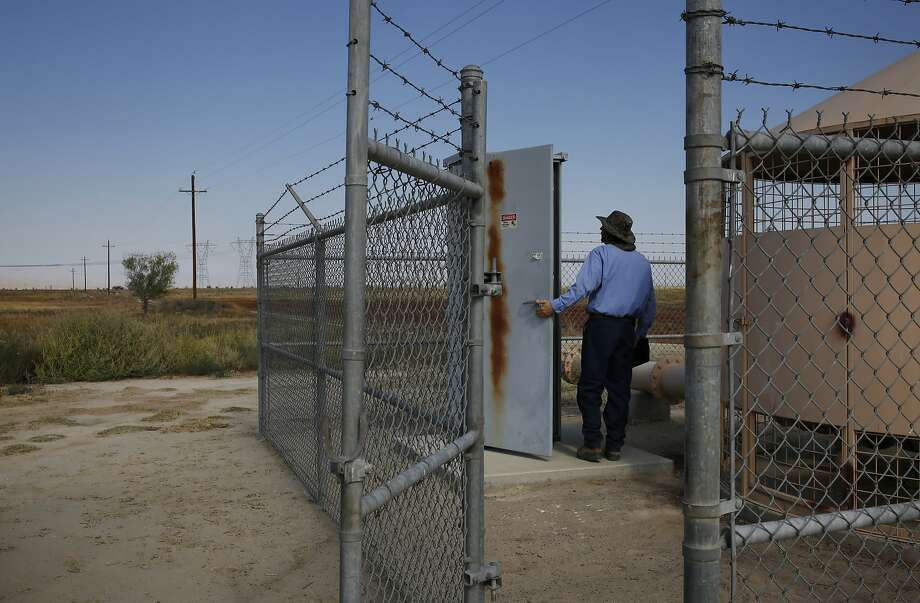David Downs, systems operator, checks on meters and a well at the Kern Water Bank July 30, 2015 in Bakersfield, Calif.  Photo: Leah Millis, The Chronicle