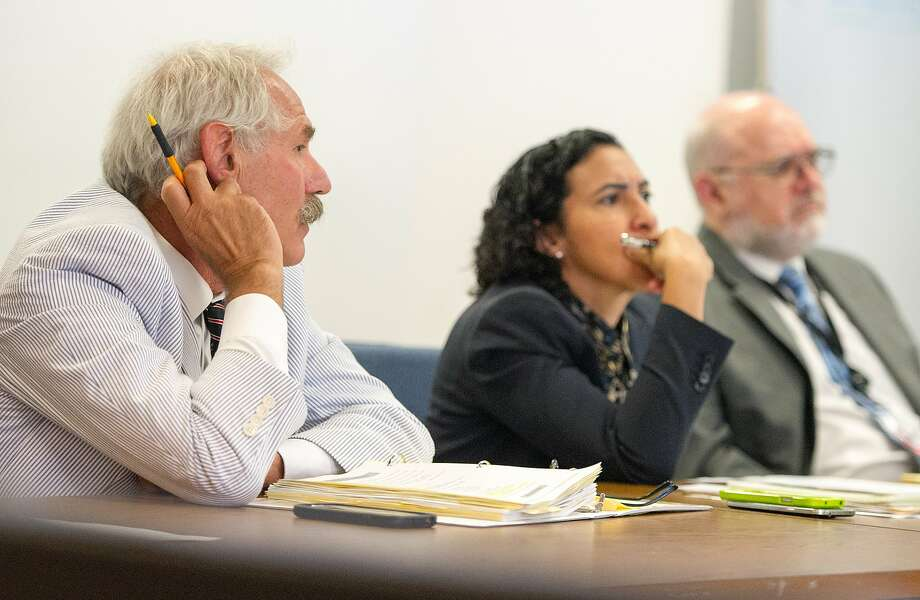 California Public Utilities President Michael Picker (L) listens during a meeting at the California Public Utilities office in San Francisco on August 26, 2015. The CPUC, which has a $5 million ratepayer-funded war chest to defend the agency in state and federal corruption probes, says it doesnÕt have the resources to turn over e-mails sought by the state attorney generalÕs office, court documents show.  (JOSH EDELSON/SPECIAL TO THE CHRONICLE) Photo: Josh Edelson, JOSH EDELSON / SAN FRANCISCO CHR