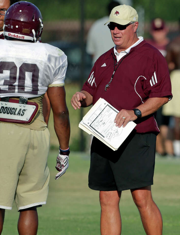 Coach Dennis Franchione works with running backs as the Texas State Bobcats practice on Aug. 22, 2015. Photo: Tom Reel /San Antonio Express-News