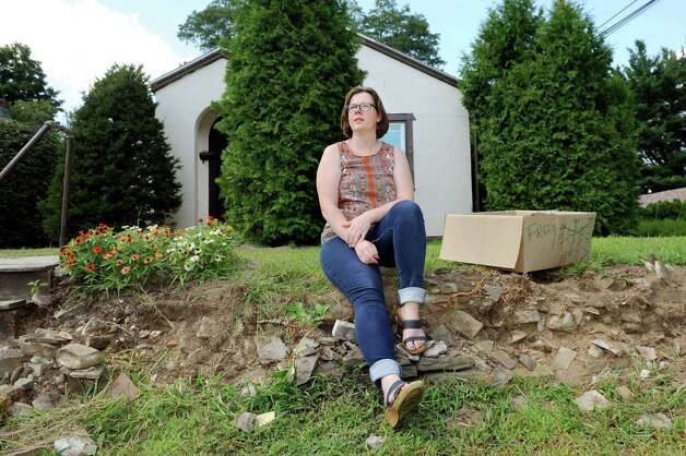 Renter Christine Daniel sits on once was a stonewall on Wednesday, Aug. 26, 2015, at her home in Rotterdam, N.Y. (Cindy Schultz / Times Union) Photo: Cindy Schultz / 00033146A