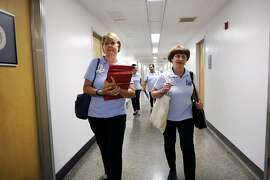 American Cancer Society Cancer Action Network staffer Cassie Ray, left, and volunteer Margo Connolly walk through the halls as they attempt to drop off petitions to select California State Assembly members at the State Capitol Building in Sacramento, CA Wednesday, August 26, 2015.