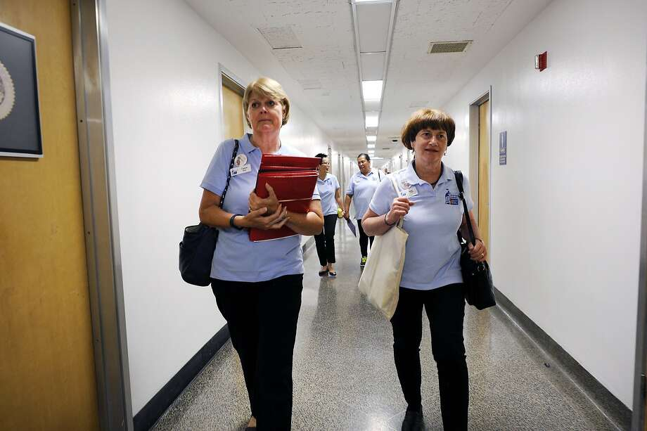 American Cancer Society Cancer Action Network staffer Cassie Ray, left, and volunteer Margo Connolly walk through the halls as they attempt to drop off petitions to select California State Assembly members at the State Capitol Building in Sacramento, CA Wednesday, August 26, 2015. Photo: Michael Short, Special To The Chronicle
