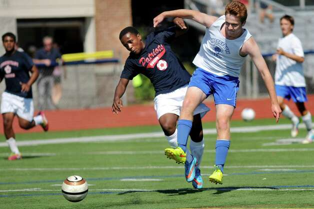 Schenectady's Kamar Galway, center, and Queensbury's Coonor Wiggins, battle for the ball during a four-team scrimmage and fundraiser for Patriot senior goalie Mahmood Shohatee on Wednesday, Aug. 26, 2015, at Schenectady High in Schenectady, N.Y. Mahmood suffered a cardiac arrest and is currently at Sunnyview Rehabilitation Hospital. (Cindy Schultz / Times Union) Photo: Cindy Schultz / 00033128A