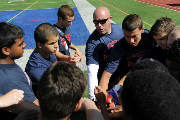 Schenectady's coach Terrence Sloan, center, leads his team in a cheer during a four-team soccer scrimmage and fundraiser for Patriot senior goalie Mahmood Shohatee on Wednesday, Aug. 26, 2015, at Schenectady High in Schenectady, N.Y. Mahmood suffered a cardiac arrest and is currently at Sunnyview Rehabilitation Hospital. (Cindy Schultz / Times Union) Photo: Cindy Schultz / 00033128A