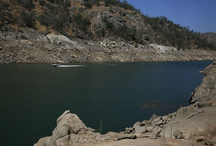 A boat passes through the spot where Temperance Flat Dam would be built on Millerton Lake in Fresno County, near Friant.  Photo: Leah Millis, The Chronicle