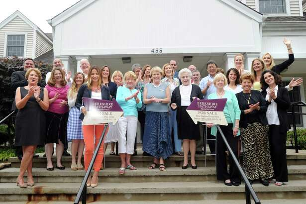 Employees of Berkshire Hathaway HomeServices New England Properties, in front of their Darien office. The company placed first in the Hearst Connecticut Top Workplaces survey in the large company category.