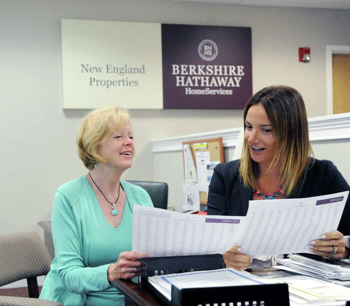 Julie Magrath, left, and Sivan Kerins, sales executives with Berkshire Hathaway HomeServices New England Properties, in their Darien office.