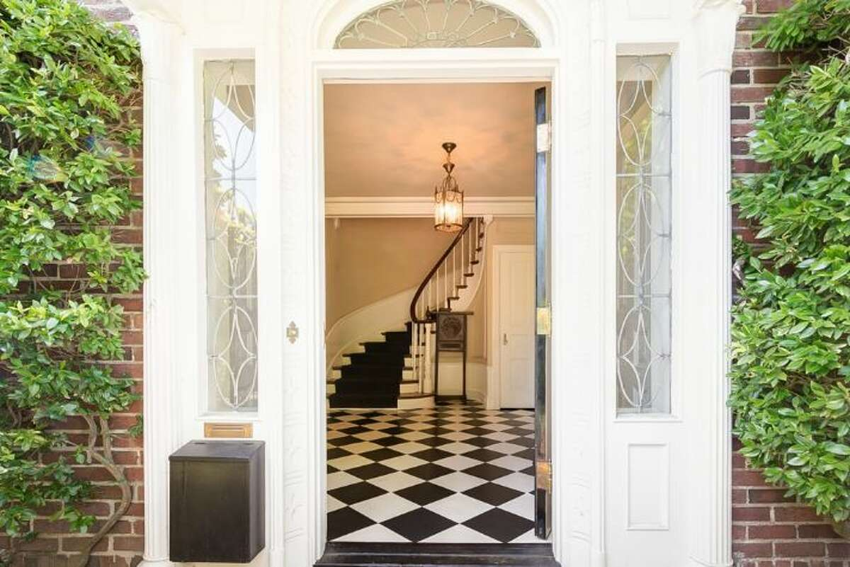 A look through the front door into the foyer of this Queen Anne five-bedroom reveals a classic, elegant entry and stairyway. For $2.4 million, this 5,290-square-foot home could be yours.