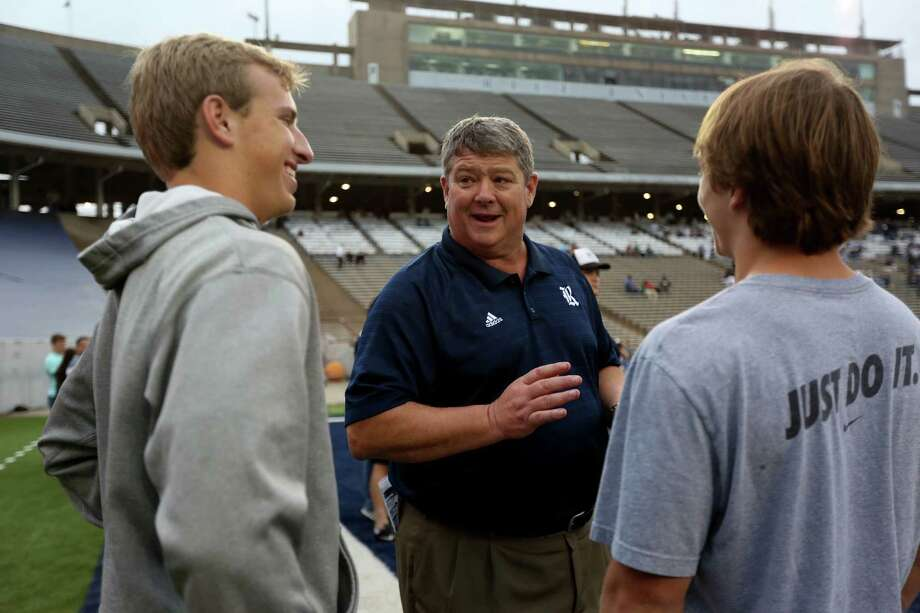 Head coach David Bailiff, center, with recruits before the start of the Rice University Blue Gray spring football game at Rice Stadium Friday, April 10, 2015, in Houston, Texas. ( Gary Coronado / Houston Chronicle ) Photo: Gary Coronado, Staff / Houston Chronicle / © 2015 Houston Chronicle