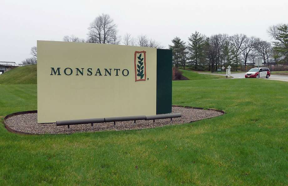 The entrance sign is seen at the headquarters of Monsanto, at Creve Coeur (St. Louis), Missouri, on April 7, 2014.  Monsanto is the world's largest seed supplier.  US agriculture and seed giant Monsanto dropped its campaign to acquire rival Syngenta August 26, 2015, saying the Swiss company refused to engage after repeated efforts to spur talks. Monsanto said it would focus on its core business after Syngenta rejected a sweetened August 18 bid that lifted the cash component of the offer and raised the break-up fee in case the deal was blocked by regulators.    AFP PHOTO / Juliette MICHEL / FILESJuliette MICHEL/AFP/Getty Images Photo: Juliette Michel, AFP / Getty Images