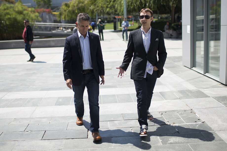 David Kahan, CEO of Birkenstock, left, wears a pair of Beneduci boots as San Francisco Chronicle Style reporter Tony Bravo, right, wears a pair of Birkenstock Arizona sandals during a walk at the Yerba Buena Gardens in San Francisco, Calif. on Tuesday, Aug. 25, 2015. Photo: Stephen Lam, Special To The Chronicle