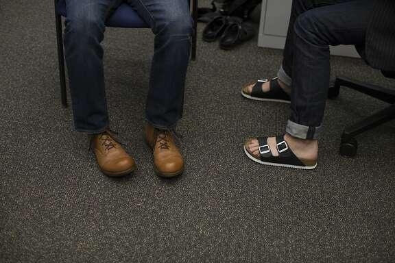 David Kahan, CEO of Birkenstock, left, wears a pair of Beneduci boots as San Francisco Chronicle Style reporter Tony Bravo, right, wears a pair of Birkenstock Arizona sandals in San Francisco, Calif. on Tuesday, Aug. 25, 2015.