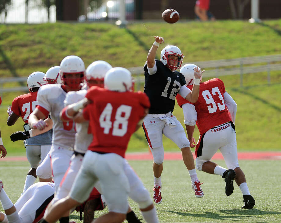 Lamar's Charles McKenzie, No. 12, passes to an open receiver during Saturday morning's scrimmage. The Lamar Cardinals offense and defense scrimmaged at Provost Umphrey Stadium on Saturday morning. Photo taken Saturday 8/15/15 Jake Daniels/The Enterprise   Manditory Credit, No Sales, Mags Out, TV OUT, Web: AP Members Only Photo: Jake Daniels / ©2015 The Beaumont Enterprise/Jake Daniels
