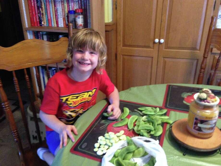 Matilda Gish shelling lima beans at her grandparents' house this summer. (Jennifer Gish)
