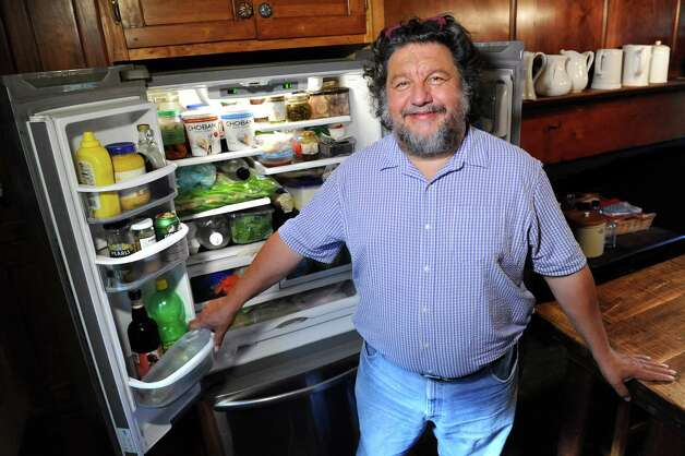 Philip Morris poses by his fridge on Wednesday, Aug. 12, 2015, at his home in Rotterdam, N.Y. (Cindy Schultz / Times Union) Photo: Cindy Schultz / 10032874A
