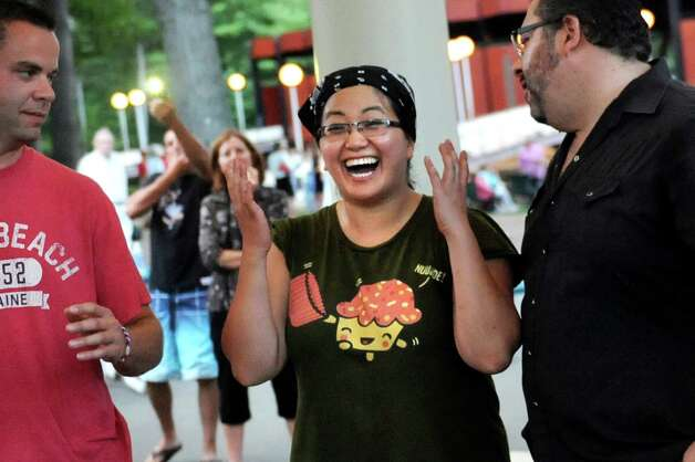 Angela Crupe of Rensselaer, center, shows her delight when she's announced the winner during the Grill Games final on Thursday, Aug. 20, 2015, at Saratoga Performing Arts Center in Saratoga Springs, N.Y. Joining her are contestants Justin Smith of Niskayuna, left, and Douglas Kinney of Clifton Park. (Cindy Schultz / Times Union) Photo: Cindy Schultz / 00033061A