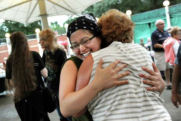 Winner Angela Crupe of Rensselaer, center, celebrates with her mother, Pat Crupe, during the Grill Games final on Thursday, Aug. 20, 2015, at Saratoga Performing Arts Center in Saratoga Springs, N.Y. (Cindy Schultz / Times Union) Photo: Cindy Schultz / 00033061A