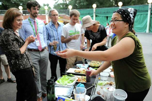 Angela Crupe of Rensselaer, right, hands out food samples to onlookers during the Grill Games final on Thursday, Aug. 20, 2015, at Saratoga Performing Arts Center in Saratoga Springs, N.Y. (Cindy Schultz / Times Union) Photo: Cindy Schultz / 00033061A