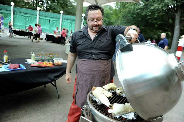Douglas Kinney of Clifton Park works the grill during the Grill Games final on Thursday, Aug. 20, 2015, at Saratoga Performing Arts Center in Saratoga Springs, N.Y. (Cindy Schultz / Times Union) Photo: Cindy Schultz / 00033061A