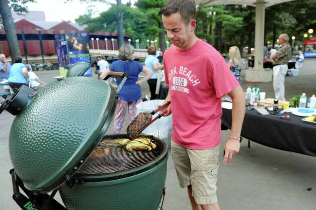 Justin Smith of Niskayuna works the grill during the Grill Games final on Thursday, Aug. 20, 2015, at Saratoga Performing Arts Center in Saratoga Springs, N.Y. (Cindy Schultz / Times Union) Photo: Cindy Schultz / 00033061A