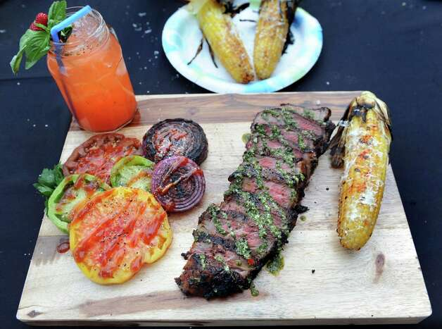 Justin Smith's Coffee-rubbed New York Strip with Chimichurri Sauce meal during the Grill Games final on Thursday, Aug. 20, 2015, at Saratoga Performing Arts Center in Saratoga Springs, N.Y. (Cindy Schultz / Times Union) Photo: Cindy Schultz / 00033061A