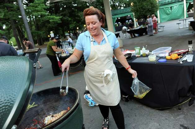 Jill Kavannagh of Troy, last year's winner, works the grill during the Grill Games final on Thursday, Aug. 20, 2015, at Saratoga Performing Arts Center in Saratoga Springs, N.Y. (Cindy Schultz / Times Union) Photo: Cindy Schultz / 00033061A