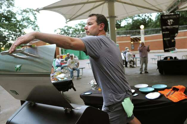 Brendan Kane of Latham works the grill during the Grill Games final on Thursday, Aug. 20, 2015, at Saratoga Performing Arts Center in Saratoga Springs, N.Y. (Cindy Schultz / Times Union) Photo: Cindy Schultz / 00033061A